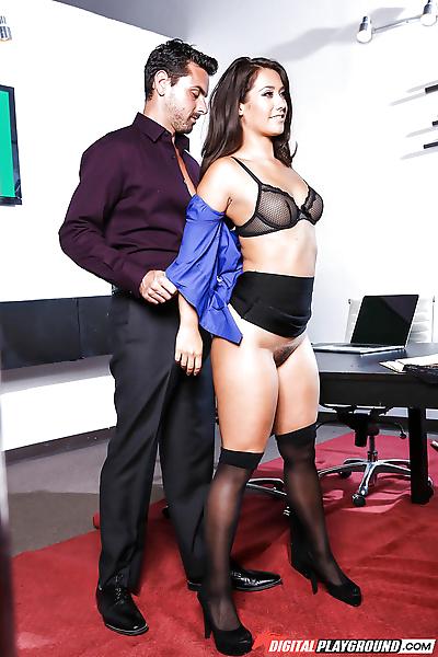 Busty brunette in stockings..
